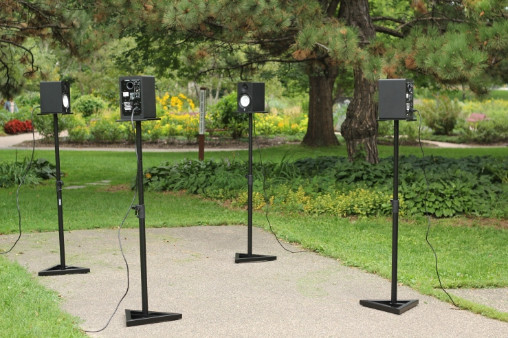 Image of four speakers set up for installation outside near Loring Park garden.